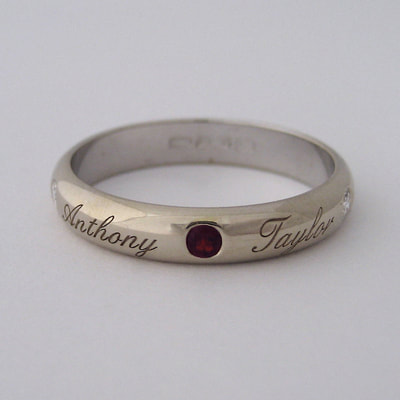 Birth ring simple half round 18K white gold diamonds ruby engraved names mommy's birth gift Daphne Meesters Jewellery Designer Goldsmith The Hague Netherlands