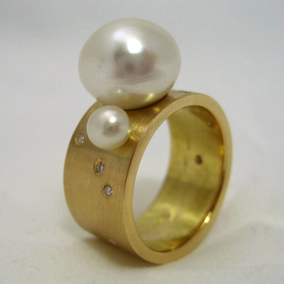 Enchanted contemporary engagement ring wide flat band 18K yellow gold pearls diamonds matte finish from inherited jewels Daphne Meesters Jewellery Designer Goldsmith The Hague Netherlands