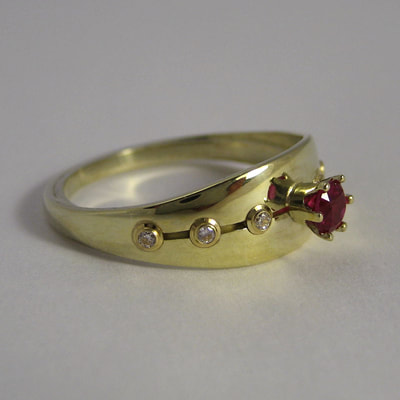 Red princess engagement ring layered line 14K yellow gold ruby diamonds Daphne Meesters Jewellery Designer Goldsmith The Hague Netherlands