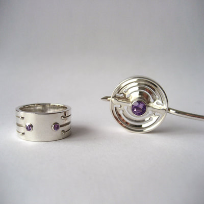 Soyuz contemporary jewellery set ring & brooch sterling silver and faceted amethyst lines pattern with balls Daphne Meesters Jewellery Designer Goldsmith The Hague Netherlands