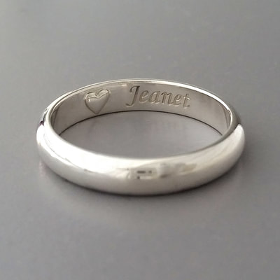 Memorial ring men's jewellery half round sterling silver plain band engraving heart ash chamber shiny finish mourning ashes cremation urn jewellery Daphne Meesters Jewellery Designer Goldsmith The Hague Netherlands
