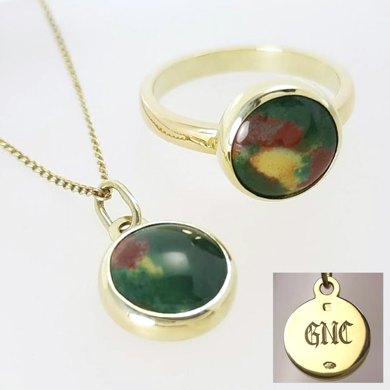 GNC pendant and ring in yellow gold with a bloodstone in dark green dark red and yellowish white high gloss finish  Daphne Meesters Jewellery  Designer Goldsmith The Hague Netherlands