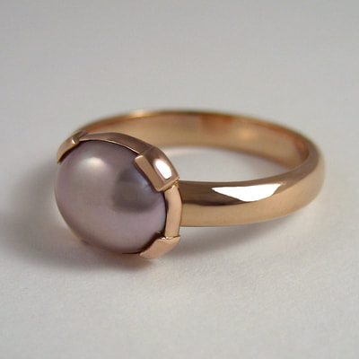 Ring half round wire 14K red gold and oval pink pearl shiny finish Daphne Meesters Jewellery Designer Goldsmith The Hague Netherlands