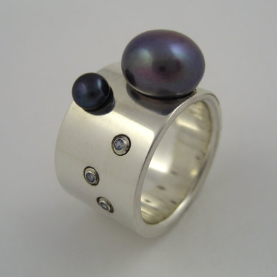 Enchanted ring sterling silver wide band pearls and topaz Daphne Meesters Jewellery Designer Goldsmith The Hague Netherlands