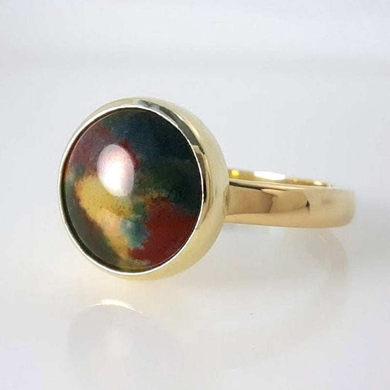 GNC ring in yellow gold with a bloodstone in dark green dark red and yellowish white high gloss finish  Daphne Meesters Jewellery  Designer Goldsmith The Hague Netherlands