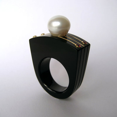 The last Tsar modern statement ring From Russia with love collection black plexiglass 14K yellow gold white pearl red ruby size 18.25 millimeters unique piece € 780,- Daphne Meesters Jewellery Designer Goldsmith The Hague Netherlands