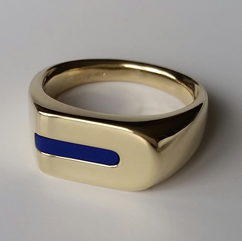 Lapis mens signet ring  remake of a long cherished model in 14 carat yellow gold with a lapis lazuli stone  Daphne Meesters Jewellery Designer Goldsmith The Hague Netherlands