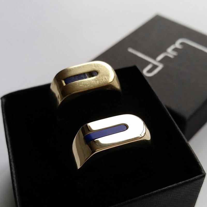 Lapis mens signet ring  remake of a long cherished model in 14 carat yellow gold with a lapis lazuli stone  old and new next to each other Daphne Meesters Jewellery Designer Goldsmith The Hague Netherlands