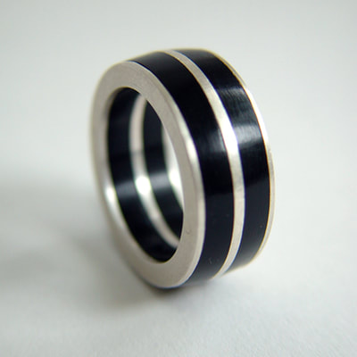 Ring unisex sterling silver and black plexiglass lines Daphne Meesters Jewellery Designer Goldsmith The Hague Netherlands
