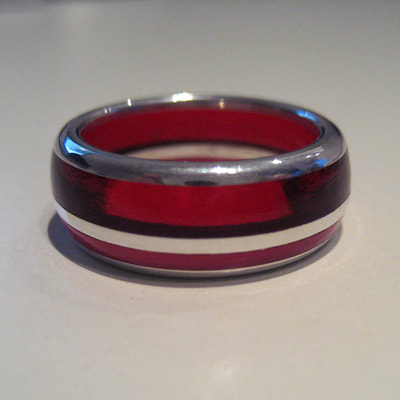 Red ring sterling silver red and pink plexiglass lines semi rounded size 17 millimeters € 195,- Daphne Meesters Jewellery Designer Goldsmith The Hague Netherlands