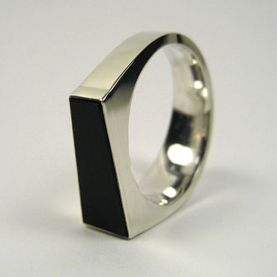 Trapezoid re-cut black onyx signet ring shiny finish sterling silver modern square Daphne Meesters Jewellery Designer Goldsmith The Hague Netherlands