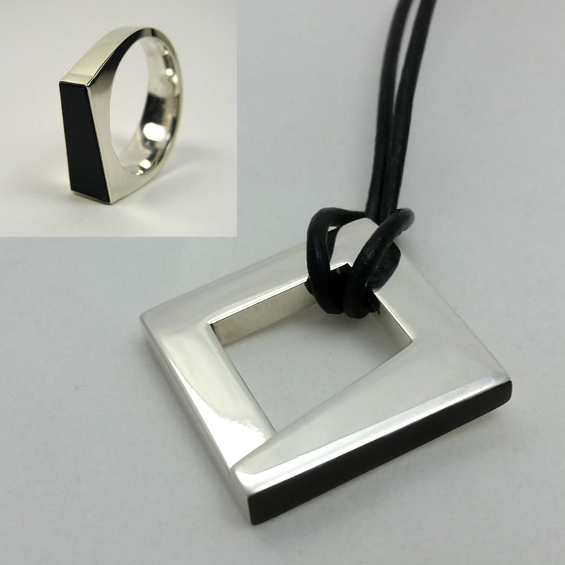 Trapezoid wedding ring and unisex wedding pendant sterling silver with re-cut black onyx from grandpa's ring square trapezoidal black surface on black leather cord shiny polish Daphne Meesters Jewellery  Designer  Goldsmith The Hague Netherlands