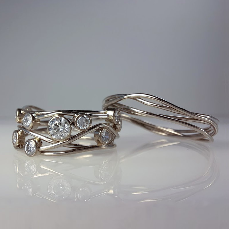 Birds nest wedding rings from 14 carat white gold wire with precious inherited diamonds in between  Daphne Meesters Jewellery Designer Goldsmith The Hague Netherlands