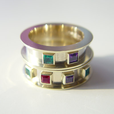 Medieval wedding bands rings contemporary wide flat high border 14K white yellow gold birthstones ruby emerald amethyst high polished handwriting engraving Daphne Meesters Jewellery Designer Goldsmith The Hague Netherlands