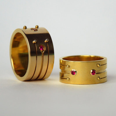 Soyuz 1 & 2 wedding bands rings From Russia with love collection modern wide layered lines 14K yellow gold rubies Daphne Meesters Jewellery Designer Goldsmith The Hague Netherlands